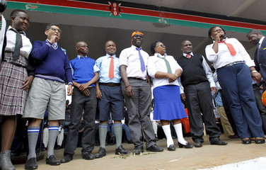 Kenya's opposition Members of Parliament dressed in school uniforms attend a rally in solidarity with teachers currently engaged in a national striker over a pay increase dispute, in capital Nairobi