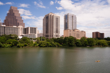 Man Kayaking Colorado River Austin Texas Downtown City Skyline