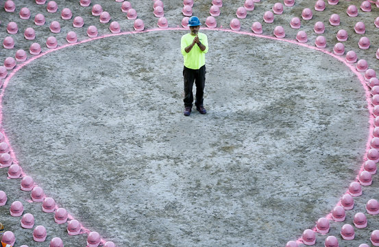 A construction worker waits to put on a pink hard hat to promote the start of  Breast Cancer Awareness Month in  La Jolla