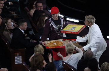 Show host Ellen DeGeneres delivers pizza to the audience at the 86th Academy Awards in Hollywood