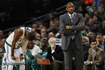 Boston Celtics' Rondo hangs his head as he talks with Celtics head coach Rivers while the San Antonio Spurs shoot a foul shot in the second half of their NBA basketball game in Boston