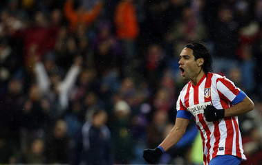 Atletico Madrid's Falcao celebrates his goal against Zaragoza during their Spanish first division soccer match in Madrid
