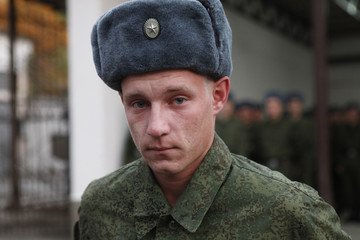 A recently drafted soldier says farewell to his mother at a conscription collection point in the southern Russian city of Stavropol