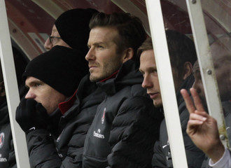 David Beckham of Paris St Germain watches the team's French Ligue 1 soccer match against Stade Reims in Reims