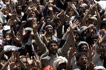 Anti-government protesters shout slogans during a rally to demand the ouster of Yemen's President Ali Abdullah Saleh outside Sanaa