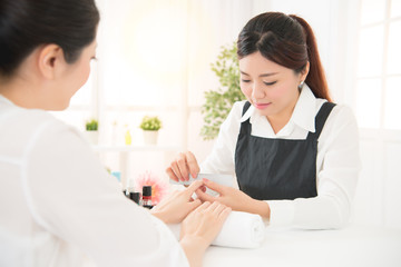 manicure in beauty salon nail filing close up