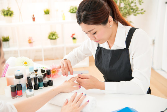 nail filing selective focus of nail salon