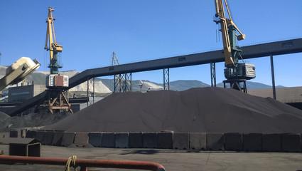 Cargo industrial port, port cranes. Loading of anthracite. Trans