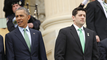 U.S. President Barack Obama and Speaker of the House Paul Ryan walk down the steps of the U.S. Capitol after Obama attended the Friends of Ireland Luncheon