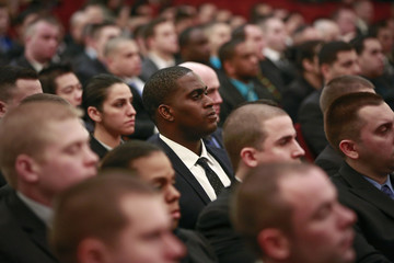 New recruits for the NYPD listen to New York City mayor Bill de Blasio speak during a swearing-in ceremony for new recruits at Queens College in New York