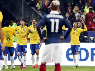Brazil's Neymar celebrates with team mates after scored against France during their international friendly soccer match at the Stade de France, in Saint-Denis