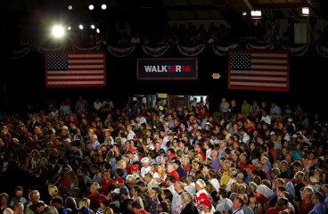 Supporters of U.S. Republican presidential candidate and Wisconsin Governor Scott Walker wait for the start of his campaign kickoff rally in Waukesha