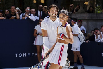 Models play tennis during an event to promote the launch of Tommy Hilfiger's new line of underwear, in New York