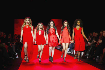 Members of 5th Harmony present creations during a presentation of the Go Red for Women Red Dress collection during New York Fashion Week