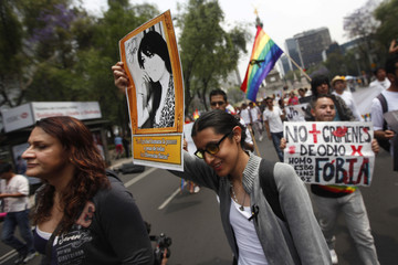 A woman holds a portrait of transgender activist Agnes Torres Hernandez during a protest against her murder, in Mexico City