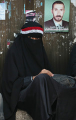 A woman looks on as she attends a rally to demand the ouster of Yemen's President Ali Abdullah Saleh at Tagheer Square in Sanaa