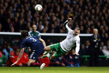 Scotland's Charlie Mulgrew challenges Ireland's Aiden McGeady during their Euro 2016 Group D qualifying soccer match at Celtic Park Stadium in Glasgow