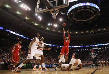 Ohio State Buckeyes' Sullinger shoots over Syracuse Orange's Joseph during the first half of their men's NCAA East Regional basketball game in Boston