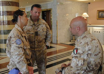 Members of the United Nations observer mission in Syria are seen at a hotel in Damascus, after a field visit to areas with protests against the regime of Syrian President Assad