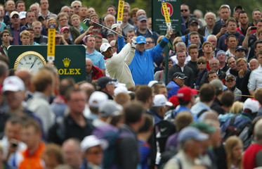 Tiger Woods of the U.S. watches his tee shot during the first round of the British Open golf championship at Royal Lytham & St Annes