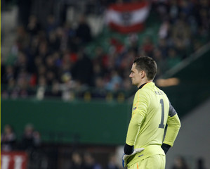 Austria's goalkeeper Macho stands on the pitch after their Euro 2012 Group A qualifying soccer match against Belgium at the Ernst Happel stadium in Vienna