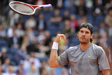 Haas of Germany throws his racket as he reacts during the final match against Monaco of Argentina at the International German Open tennis tournament in the Rothenbaum stadium at Hamburg