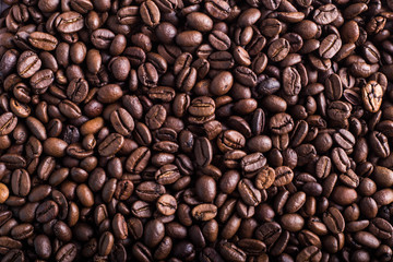 Coffee bean texture, background, copy plase. Place for text or inscription. Top view.