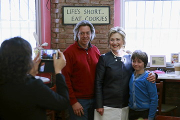 U.S. Democratic presidential candidate Hillary Clinton poses for a photograph with supporters at the bakery Make My Cake in New York