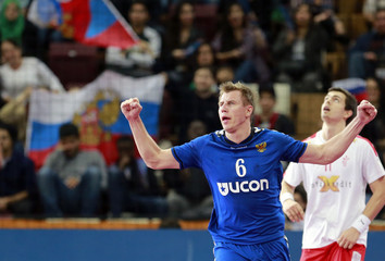 Shishkarev of Russia celebrates a goal against Denmark during their preliminary round of the 24th men's handball World Championship in Doha