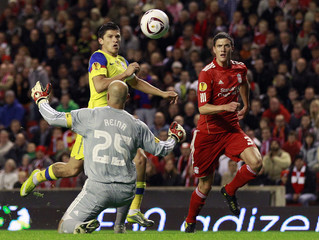 Steaua Bucharest's Tanase scores past Liverpool's Reina during their Europa League soccer match in Liverpool