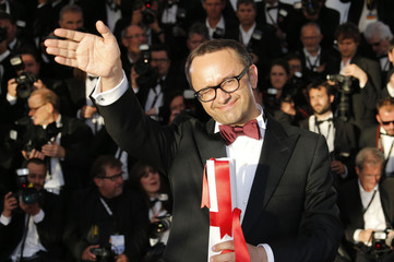 """Director Andrey Zvyagintsev, Best screenplay award winner for his film """"Leviathan"""", poses during a photocall at the closing ceremony of the 67th Cannes Film Festival in Cannes"""