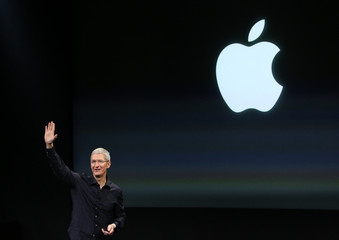 Apple CEO Tim Cook speaks during a presentation at Apple headquarters in Cupertino