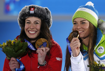 Joint gold medalists Switzerland's Gisin and Slovenia's Maze laugh during the medal ceremony for the women's alpine skiing downhill race at the Sochi 2014 Winter Olympic Games in Sochi