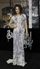 """Hudgens poses at the premiere of """"Sucker Punch"""" at the Grauman's Chinese theatre in Hollywood"""