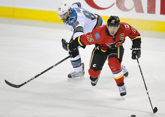 Calgary Flames' Iginla tries to get past San Jose Sharks' Burns during their NHL hockey game in Calgary.