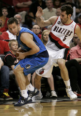 Trail Blazers' Fernandez defends against Mavericks' Barea during Game 4 of their NBA Western Conference first round playoff series in Portland