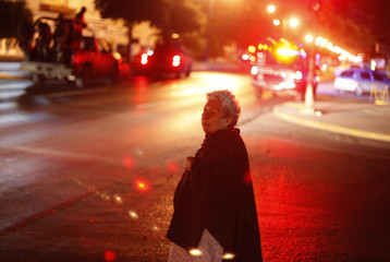 A woman looks at a crime scene in downtown Monterrey