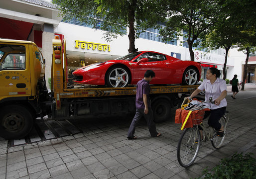 File picture of a Ferrari 458 Spider loaded onto a truck after being bought by a young Chinese at its showroom in Shenzhen