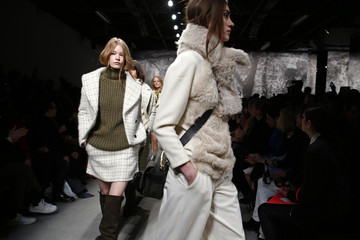 Models present creations by French designer Sophie Albou as part of her Fall/Winter 2014-2015 women's ready-to-wear fashion show for fashion house Paul & Joe during Paris Fashion Week