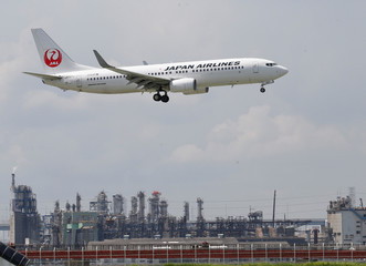 JAL's airplane flies nearby Haneda Airport in Tokyo