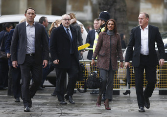 Gina Miller is escorted by bodyguards as she arrives at the Supreme Court in Parliament Square, central London