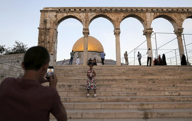 A Palestinian man takes a picture in Jerusalem's Old city