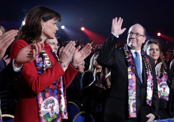 Prince Albert II of Monaco waves as Princess Stephanie looks on during the gala of the 41st Monte-Carlo International Circus Festival in Monaco