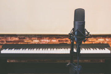 condenser microphone on piano background, vintage filter