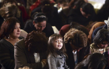 An Egyptian Coptic Christian girl attends the Coptic Christmas eve mass at the main cathedral of a church in Cairo