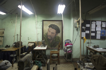 An image of Cuban revolutionary hero Ernesto 'Che' Guevara is seen inside a tailoring factory in downtown Havana,