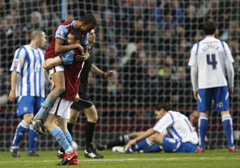 Fabian Delph of Aston Villa celebrates with James Milner after scoring against Brighton and Hove Albion during their English FA Cup soccer match at Villa Park in Birmingham