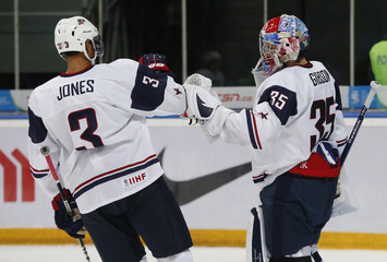 Team USA's goalie Gibson celebrates with Jones after they defeated the Czech Republic during their quarter-final game at the 2013 IIHF U20 World Junior Hockey Championship in Ufa