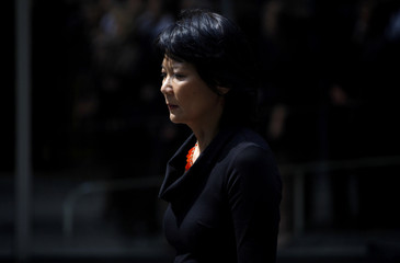 Olivia Chow follows the hearse carrying her husband, NDP Opposition Leader Jack Layton, during a procession en route to his state funeral in Toronto