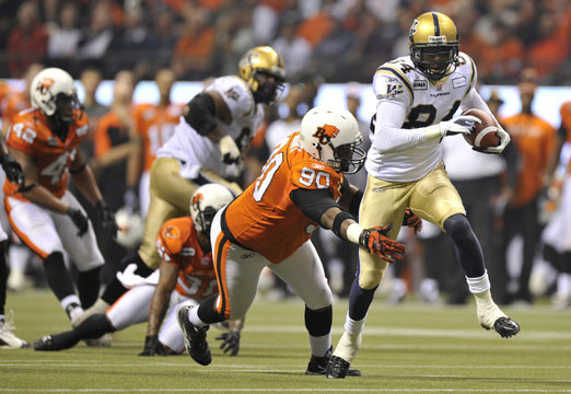 Winnipeg Blue Bombers' Greg Carr breaks away from BC Lions' Aaron Hunt in the first half of the CFL's 99th Grey Cup football game in Vancouver
